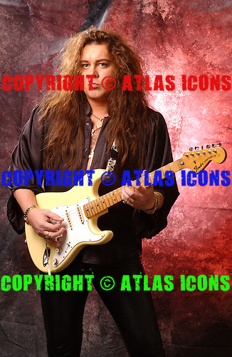 MIAMI JULY 7: Yngwie Malmsteen poses in the studio on July 7, 2002 in Miami Florida. Photo by Larry Marano © 2002