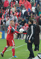 20 October 2012: Montreal Impact head coach Jesse Marsch hands the ball over to Toronto FC defender Richard Eckersley #27 during an MLS game between the Montreal Impact and Toronto FC at BMO Field in Toronto, Ontario Canada. .The ended in a 0-0 draw..