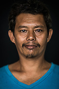 41 year old Tuna fisherman, Rosuel Pilapil poses for a portrait at the Casa, the Tuna buying house in Puerto Princesa, Palawan in the Philippines. <br /> Photo: Sanjit Das/Panos for Greenpeace