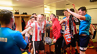 Lincoln City's goalkeeping coach Jimmy Walker, left, sprays champagne over the players as they celebrate in the changing rooms after the game<br /> <br /> Photographer Chris Vaughan/CameraSport<br /> <br /> Vanarama National League - Lincoln City v Macclesfield Town - Saturday 22nd April 2017 - Sincil Bank - Lincoln<br /> <br /> World Copyright &copy; 2017 CameraSport. All rights reserved. 43 Linden Ave. Countesthorpe. Leicester. England. LE8 5PG - Tel: +44 (0) 116 277 4147 - admin@camerasport.com - www.camerasport.com
