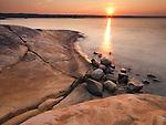 Red sunrise landscape nature scenery of rocks on a shore of Georgian Bay at Killbear Provincial Park, Ontario, Canada.