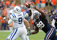Virginia NT Nate Collins (98) puts pressure on Duke quarterback Thaddeus Lewis (9) during an ACC football game Saturday in Charlottesville, VA. Duke won 28-17. Photo/Andrew Shurtleff