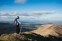 Female hiker enjoys view from Fan Y Big looking towads Brecon, Brecon Beacons national park, Wales