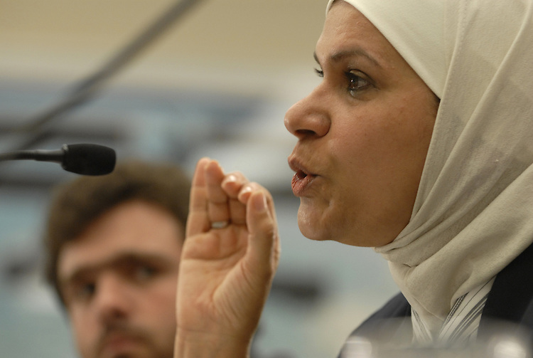 Faiza al-Arji, testified about her family's experiences in Iraq before and during the war and subsequent occupation of her country during a forum on how to end the war in Iraq. In the background is Charlie Anderson. Anderson served as a Navy Hospital Corpsman with the Marine Corps' Second Tank Battalion during the invasion of Iraq and is the Southeast Regional Coordinator of Iraq Veterans Against the War.