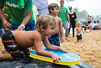PIPELINE, Oahu, Hawaii (Sunday, December 8, 2013) Axel Irons (HAW) son of Andy Irons (HAW) celbrating his 3rd birthday on the beach during the contest. - The opening day of the Billabong Pipe Masters, in Memory of Andy Irons, commenced today in firing six-to-eight foot (2 metre) waves and the world's best surfers put on an incredible display of technical barrel riding at Pipeline and Backdoor to complete Rounds 1 and 2. The Billabong Pipe Masters is the third and final leg of the Vans Triple Crown of Surfing.<br /> <br /> The final stop on the ASP World Championship Tour (WCT), the Billabong Pipe Masters will decide the 2013 ASP World Title Race, the coveted Vans Triple Crown of Surfing Champion and the final qualification slots for next season's Top 34. <br /> Gabriel Medina (BRA), 19, would put together an amazing show at the iconic lefts of Pipeline to kick off the Billabong Pipe Masters, navigating through a heavy barrel on his opening score to post a near-perfect 9.67. The Brazilian Prodigy would quickly back up the ride, earning an additional 9 point score for another deep Pipe tube punctuated with a massive alley-oop, eliminating Bruce Irons (HAW), 34. Medina's unlikely aerial at Pipeline puts him in the running for a 250,000 mile prize from   Hawaiian Airlines Airshow award.<br /> Sebastian Zietz (HAW), 25, defending Vans Triple Crown of Surfing Champion, immediately found his rhythm at Pipeline, earning the first perfect 10-point ride of Billabong Pipe Masters competition for an unbelievable Backdoor barrel.<br /> Photo: joliphotos.com