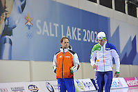 SCHAATSEN: SALT LAKE CITY: Utah Olympic Oval, 14-11-2013, Essent ISU World Cup, training, Johan de Wit (trainer/coach Team Project 2018), Rhian Ket (NED), ©foto Martin de Jong