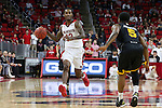 27 November 2015: NC State's Anthony (Cat) Barber (12) and Winthrop's Keon Johnson (5). The North Carolina State University of North Carolina Wolfpack hosted the Winthrop University Eagles at the PNC Arena in Raleigh, North Carolina in a 2015-16 NCAA Division I Men's Basketball game. NC State won the game 87-79.