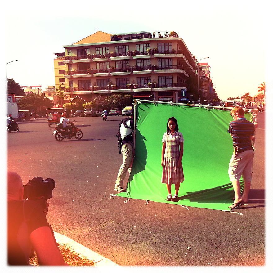 The green screen here will allow us to marry a time-lapse shot of a busy intersection in Phnom Penh with a video portrait of Sokha. If all goes well, we'll have the makings for an interesting effect.