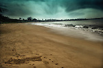 A stormy day in Loquillo beach in Puerto Rico with waves and palm trees