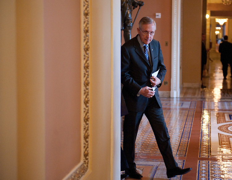 UNITED STATES - SEPTEMBER 20: Senate Majority Leader Harry Reid, D-Nev., walks to the microphones in the Ohio Clock Corridor after the Senate Democrats' policy lunch on Tuesday, Sept. 20, 2011. (Photo By Bill Clark/Roll Call)