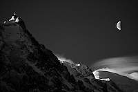 Early morning Aiguille du Midi, Mont Blanc clouds and moon.