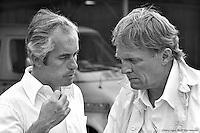 HAMPTON, GA - APRIL 22: Roger Penske (left) with Dan Gurney in the garage area before the start of the Gould Twin Dixie 125 event on April 22, 1979, at Atlanta International Raceway near Hampton, Georgia.