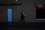 Motherwell 3 Dundee 1, 12/12/2015. Fir Park, Scottish Premiership. A spectator marking his way towards a turnstile at Fir Park, home to Motherwell Football Club, before they played Dundee in a Scottish Premiership fixture. Formed in 1886, the  home side has played at Fir Park since 1895. Motherwell won the match by three goals to one, watched by a crowd of 3512 spectators. Photo by Colin McPherson.