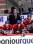 15 October 2009: Montreal Canadiens new Head Coach Jacques Martin looks out from behind the bench during his first home game of the season in Montreal against the Colorado Avalanche at the Bell Centre in Montreal, Quebec, Canada. The Avalanche edged out the Habs 3-2 in Montreal's season home opener. Mandatory Credit: Ed Wolfstein Photo