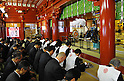 January 4, 2012, Tokyo, Japan - A Shinto priest gives God's blessing to a group of business persons on the traditional first business day in 2012 at Kanda Shrine in downtown Tokyo on Wednesday, January 4, 2012. Thousands of people turned out to celebrate the new year and make their wishes in a traditional rite at the Shinto shrine which dates back 1,270 years. (Photo by Natsuki Sakai/AFLO) [3615] -mis-