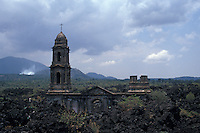 The ruined Templo de San Juan Parangaricutiro near Angahuan, Michoacan, Mexico. In 1943, this church was half-buried by a lava flow from nearby Volcan Paricutin.