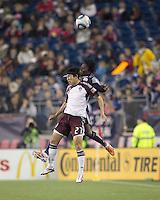 Colorado Rapids midfielder Kosuke Kimura (27) and New England Revolution forward Kenny Mansally (7) battle for head ball. In a Major League Soccer (MLS) match, the New England Revolution tied the Colorado Rapids, 0-0, at Gillette Stadium on May 7, 2011.