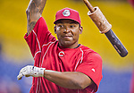 4 April 2015: Cincinnati Reds outfielder Marlon Byrd awaits his turn in the batting cage prior to an exhibition game against the Toronto Blue Jays at Olympic Stadium in Montreal, Quebec, Canada. The Blue Jays defeated the Reds 9-1 in the second of two MLB weekend exhibition games. The series marked the first time since 2004 that the Reds played at Olympic Stadium, during the last season of the Montreal Expos. Mandatory Credit: Ed Wolfstein Photo *** RAW (NEF) Image File Available ***