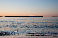 Mackinac Island seen across Lake Huron from St. Ignace Michigan at dawn.