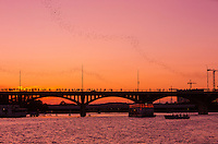 The nightly emergence of the bats from underneath the bridge at dusk, and their flight across Lady Bird Lake primarily to the east, to feed themselves, attracts as many as 1,000,000 tourists annually. Tourists can see the bats from the bridge, from the sides of the river and from boats.