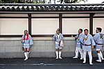 "Participants find shade from the heat during the Kanamara ""Penis"" Festival in Kawasaki, Japan."