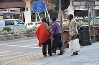 Grace Mugabe with red scarf and glasses,  (subject to identification) and friend with security in Hong Kong's, Kowloon 15th Jan 2005.<br /> <br /> photo &copy;&nbsp;by Sinopix