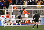 Clemson's Josh Brown (18) heads the ball out of the hands of New Mexico goalkeeper Mike Graczyk (1) leading to Clemson's goal at 39:23. The University of New Mexico Lobos defeated the Clemson University Tigers 2-1 in a Men's College Cup Semifinal at SAS Stadium in Cary, NC, Friday, December 9, 2005.