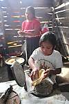 A Native nahuatl mothers and her six-years-old daughter prepare tamales in their village of Acaxochitlan village, in northern state of Hidalgo, during the festivities of the Day of the Deads. Hundreds of Native villages pay homage to their deads on the eve of November 2 as a tradition since the preHispanic times. Photo by Heriberto Rodriguez