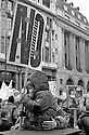 A young child takes a rest from the anti war protest. London, 15/02/2003