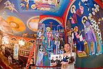 St. Sava frescos by Miloje Milinkovic'..N.W. corner alcove of St. Sava Church--Miloje displays photos taken by Larry Angier in 1996 of the blessing by Bishop Jovan in preparation of the start of the project