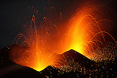 Strombolian eruption throwing glowing volcanic bombs from vents along eruptive fissure of Fogo Volcano, Cape Verde