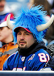 20 December 2009: A Buffalo Bills fan watches in the stands during a game against the New England Patriots at Ralph Wilson Stadium in Orchard Park, New York. The Patriots defeated the Bills 17-10. Mandatory Credit: Ed Wolfstein Photo