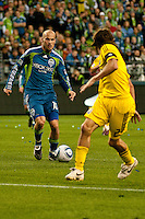 Freddie Ljungberg(10) of the Seattle Sounders moves the ball against Frankie Hejduk(2) of the Columbus Crew at the XBox 360 Pitch at Quest Field in Seattle, WA on May 1, 2010. the Sounders and Crew played to a 1-1 draw.