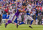 19 October 2014: Buffalo Bills wide receiver Sammy Watkins is pursued by Minnesota Vikings cornerback Josh Robinson on an 18-yard gain in the game-winning drive of the fourth quarter against the Minnesota Vikings at Ralph Wilson Stadium in Orchard Park, NY. The Bills defeated the Vikings 17-16 in a dramatic, last minute, comeback touchdown drive. Mandatory Credit: Ed Wolfstein Photo *** RAW (NEF) Image File Available ***