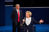 ST LOUIS, MO - OCTOBER 09: Republican presidential nominee Donald Trump listens as Democratic presidential nominee former Secretary of State Hillary Clinton speaks during the town hall debate at Washington University on October 9, 2016 in St Louis, Missouri. This is the second of three presidential debates scheduled prior to the November 8th election.