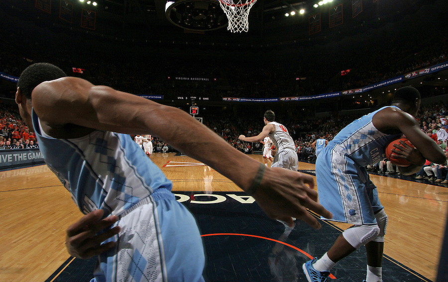 North Carolina  players handle the ball during an NCAA basketball game against Virginia Monday Jan. 20, 2014 in Charlottesville, VA. Virginia defeated North Carolina 76-61.