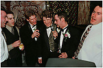 The groom and his groomsmen belt out a song during a karaoke session late into the wedding reception.