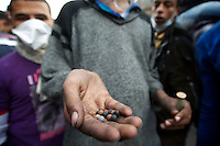A egyptian protestor holds rubber bullets shot by the security forces during clashes with protestors in central Cairo.