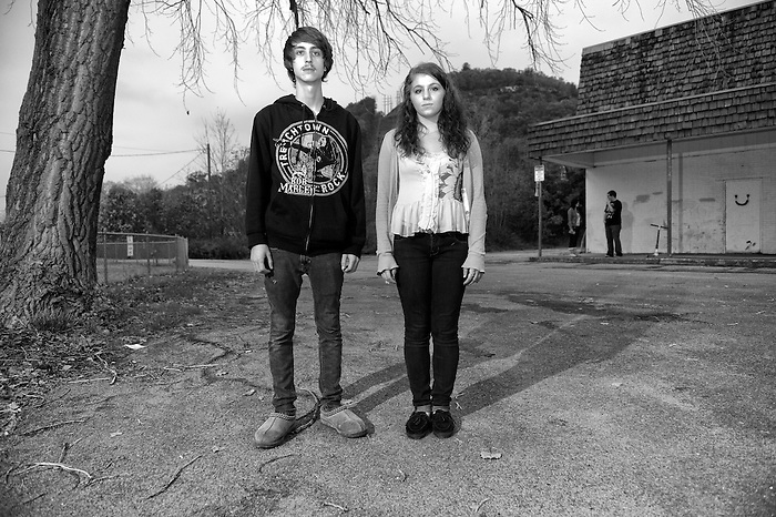 A Teenage couple outside of a shopping area