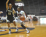 "Mississippi's Valencia McFarland (3) drives against Vanderbilt's Jasmine Lister (11) at the C.M. ""Tad"" Smith Coliseum in Oxford, Miss. on Sunday, January 2, 2011. Mississippi won 72-67. (AP Photo/Oxford Eagle, Bruce Newman)"