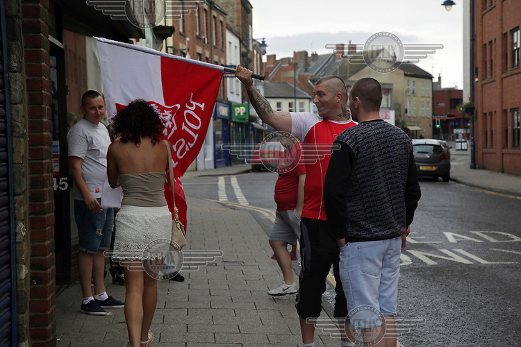 Polish football fans outside a pub where they are watching their national team playing in the Euro 2016 tournament. <br /> The town of Boston had the country's highest proportion of 'leave' votes cast in the EU referendum with almost 76 percent of ballots cast for Brexit. Lincolnshire has, in recent years, seen an influx of EU workers drawn to the area's agricultural industry. The 2011 census found about 13 percent of Boston's residents were born in Eastern Europe and migrated to the UK since 2004.