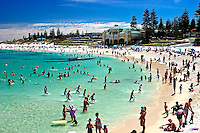 A typical summer day at Cottesloe Beach, crystal clear water, white sand and a blue sky.