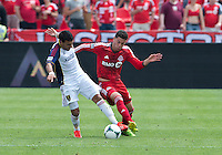 29 June 2013: Toronto FC midfielder Jonathan Osorio #21 battles for a ball with Real Salt Lake midfielder Javier Morales #11during an MLS game between Real Salt Lake and Toronto FC at BMO Field in Toronto, Ontario Canada.<br /> Real Salt Lake won 1-0.