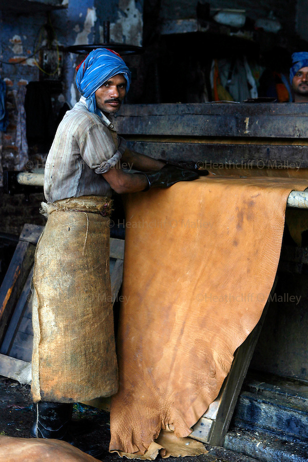 Kanpur, India. Wednesday 14 March.Workers in a leather tannery,one of 300 in the industrial city of Kanpur, factories like these are being blamed for the toxic substances being dumped into the Ganges .     .  The Ganges river is 1557 miles long and stretches from the Himalayas to the Indian Port of Calcutta, supplying water to one twelth of the worlds population. .  The Ganges is worshipped in the Hindu faith and is believed to be not only a source of life but also able to wash one's sins away, and Hindu's from across the globe make pilgrimage to the river referring to it as Ma Ganga.