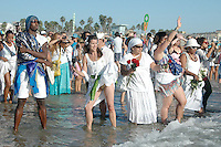 People honor the Sea with flowers during the 2011 World Festival of Sacred Music Opening at Santa Monica Beach on Saturday, October 1, 2011.