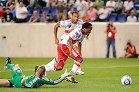 Dane Richards (19) of the New York Red Bulls gets past San Jose Earthquakes goalkeeper Jon Busch (18) to score during a Major League Soccer (MLS) match at Red Bull Arena in Harrison, NJ, on August 28, 2010.