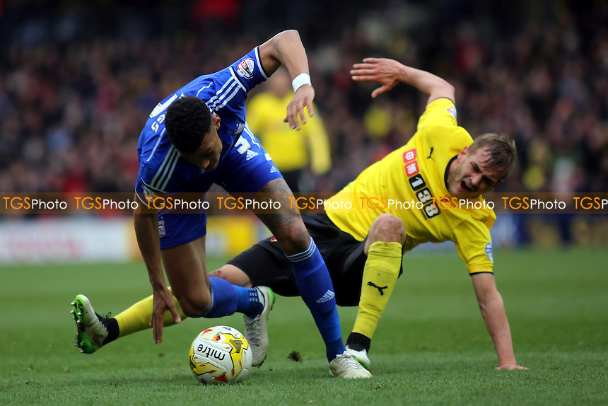 As Tyrone Mings of Ipswich turns with the ball, Watford's Joel Ekstrand looks to twist his knee and falls to the ground. Moments later he was taken off on a stretcher - Watford vs Ipswich Town - Sky Bet Championship Football at Vicarage Road Stadium, Watford, Hertfordshire - 21/03/15 - MANDATORY CREDIT: Paul Dennis/TGSPHOTO - Self billing applies where appropriate - contact@tgsphoto.co.uk - NO UNPAID USE
