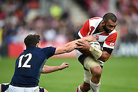 Michael Leitch of Japan looks to get past Matt Scott of Scotland. Rugby World Cup Pool B match between Scotland and Japan on September 23, 2015 at Kingsholm Stadium in Gloucester, England. Photo by: Patrick Khachfe / Onside Images