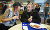 Crisis at Christmas, London, Great Britain <br /> 23rd December 2016 <br /> <br /> Volunteer Hannah talks to Guest John who is having breakfast <br /> <br /> First day of operations at one of the Crisis centres in London.<br /> <br /> Crisis at Christmas is a lifeline for thousands of homeless people across the UK, offering support, companionship and vital services over the festive period.<br />  <br /> Crisis at Christmas provides immediate help for homeless people at a critical time - one in four homeless people spends Christmas alone - but our work does not end there. We encourage guests to take up the life-changing opportunities on offer all year round at our centres across the country. <br />  <br /> Crisis is the national charity for homeless people.<br /> <br /> Crisis reveals scale of violence and abuse against rough sleepers as charity opens its doors for Christmas<br /> <br /> People sleeping on the street are almost 17 times more likely to have been victims of violence and 15 times more likely to have suffered verbal abuse in the past year compared to the general public, according to new research from Crisis, the national charity for homeless people.<br />  <br /> <br /> Photograph by Elliott Franks <br /> Image licensed to Elliott Franks Photography Services
