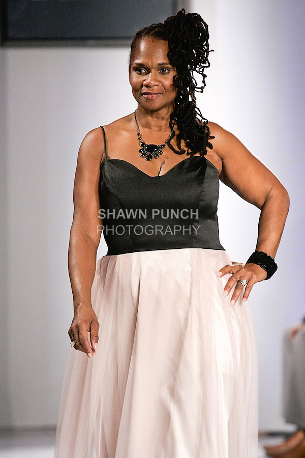 Model walks the runway in an outfit from the Ms. Chalane Spring Summer 2012 fashion show, during BK Fashion Weekend Spring Summer 2012.
